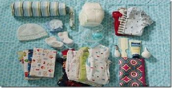 صورة اغراض شنطة الولاده بالصور